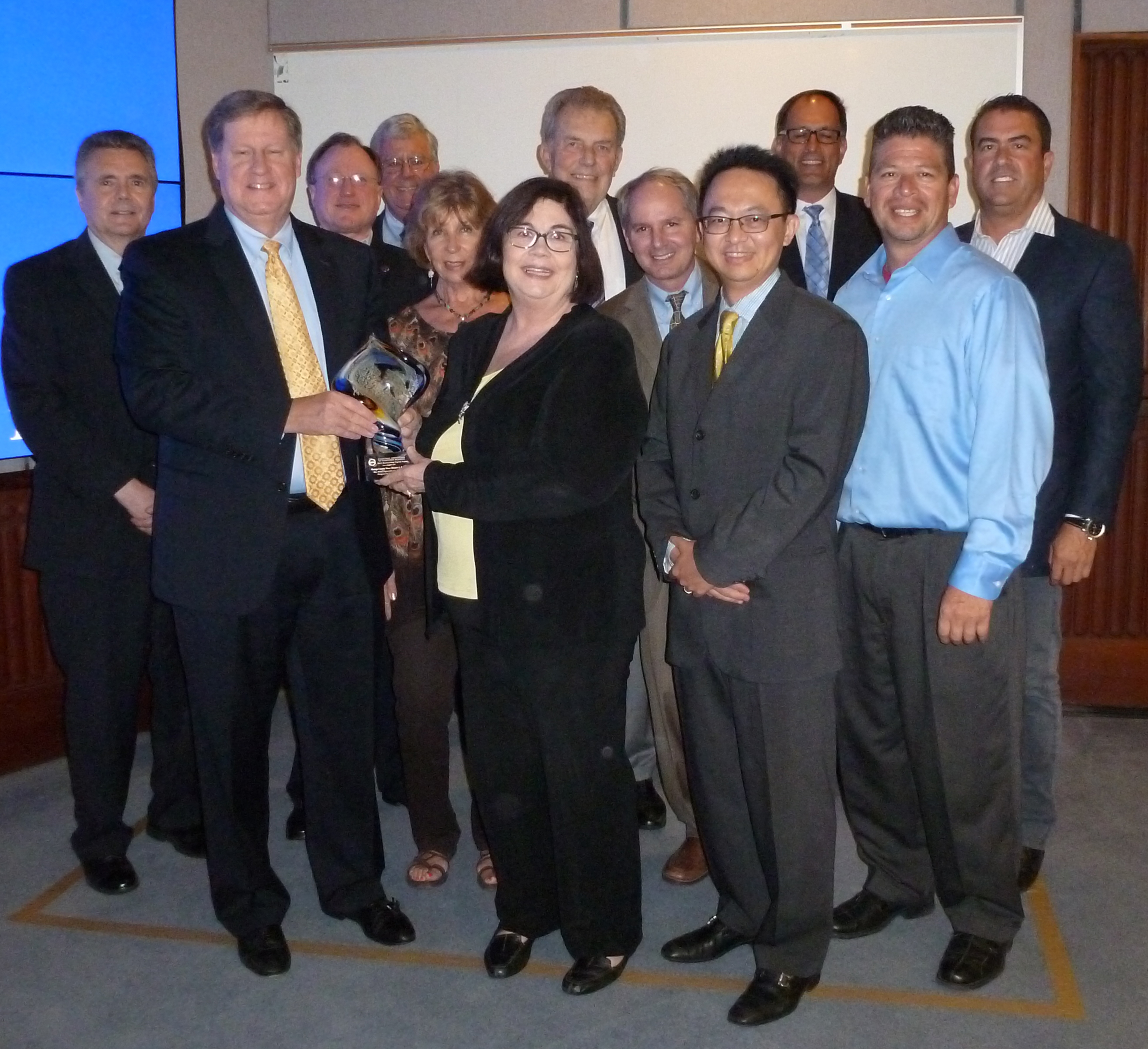 Board members and general managers from OCWD and OCSD accept the CASA Achievement Award at the Sept. 16 OCWD Board Meeting